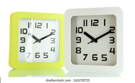 Two office clocks, isolated on white