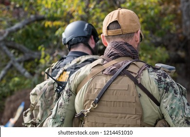 Two officers from the back wearing tactical gear