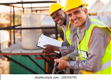 two oil and chemical industry technicians in plant