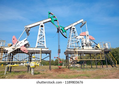 Two oil pumps on a blue sky background