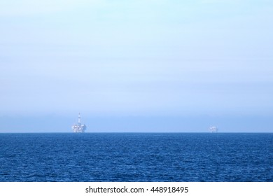 Two oil rigs in front of the Ventura coast.