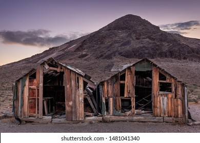 Two old abandoned log cabin in minerary ghost town Rhyolite at dusk