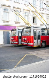 Two old, articulated trolleybuses in the center of Budapest, Hungary