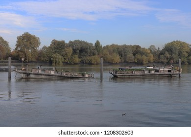 Two old barges on the river Thames in Wandsworth