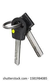 Two old black keys on keyring isolated on white background