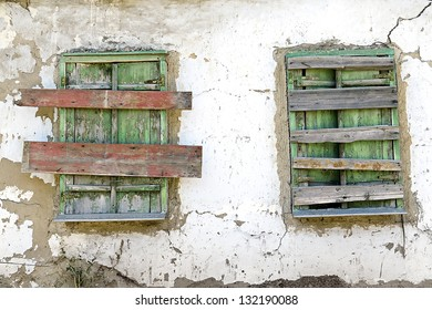 two old boarded-up window on the wall