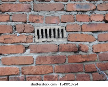 two old brick walls with uneven and broken edges of the bricks of the refractory brick vent.