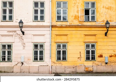 Two old buildings of yellow and beige colors, facade