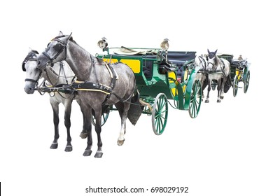 Two old carriages pulled by a couple of horses (Wien - Austria - Europe) - image isolated on white background for easy selection