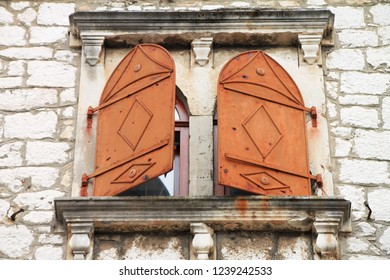 Two old closed windows on stone wall in Mostar , Bosnia and Herzegovina