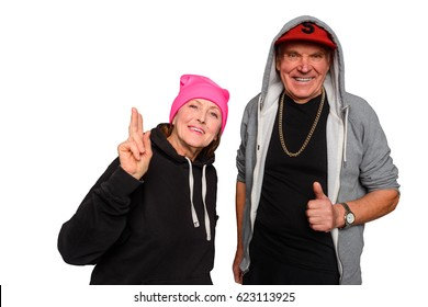 Two old and crazy pensioners. Friendly smiling couple shows OK gestures, it seems like they're having good time at a party. Isolated on white.