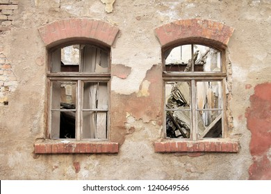 Two old destroyed windows on abandoned house , Bosnia and Herzegovina