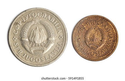 Two old, dirty coins from 1980's Yugoslavia - 1 dinar and 25 para with the old yugoslavian coat of arms. High resolution macro photograph.