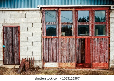 Two old doors of a garage in the rural Finland. The harsh weather puts the wooden doors to the test.