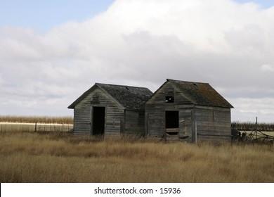 Two old grain bins on the prairies.