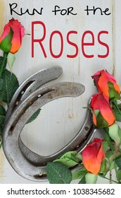 Two old horse shoes paired with silk red roses on a white-washed rustic wooden background makes a nice image with contrasting elements. Good for Kentucky Derby or any other equestrian theme.