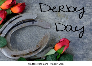 Two old horse shoes paired with silk red roses on a scratched up steel background make a nice image with contrasting elements of silk and steel. Text added for Kentucky Derby theme