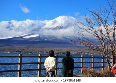 Two Old Japanese Women Looking to Fuji Volcano Mountain at Lake Yamanaka During Autumn