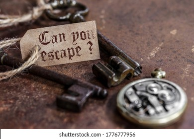 two old keys on a rusty metal table with labels : can you escape ?