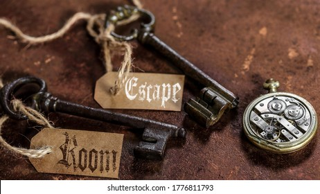 two old keys on a rusty metal table with labels : escape room