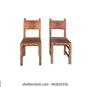 Two old leather and wood chairs isolated on white.