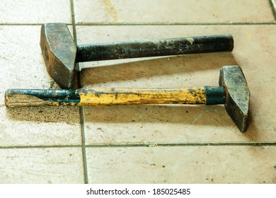Two old metal sledge hammers hand tools in mechanic garage car service