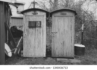 two old metal toilet houses
