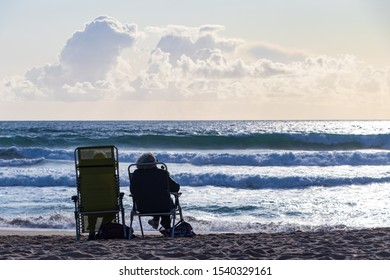Two old people by the sea