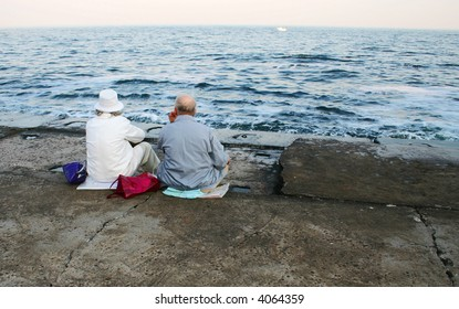 Two old people on the beach