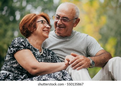 Two old people relax and smile
