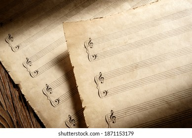 two old piano music heets ready to write musical notation