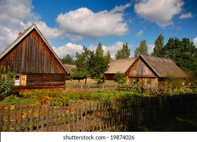 Two old polish cottages in countryside with nice sunny skies