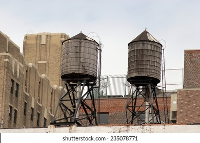 Two old style wooden water tanks on rooftop, Greenwich Village, Manhattan, New York