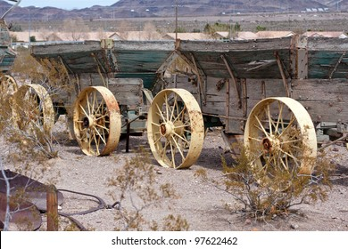 two old wild west wagons in a row with metak wheels