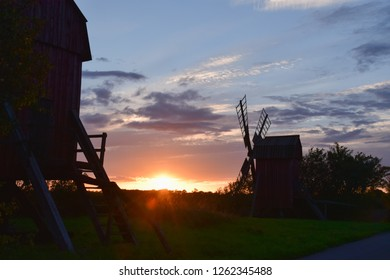 Two old windmills by sunset at the swedish island Oland in the Baltic Sea