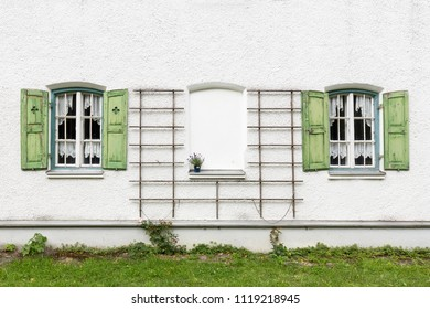Two old windows with wooden shutters on a residential home in Germany