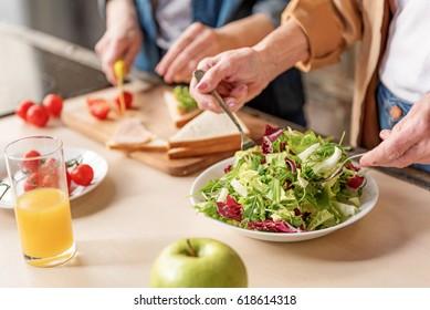 Two old women preparing healthy food