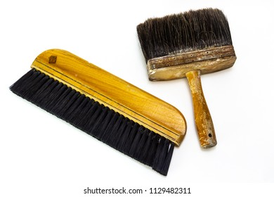 Two old, wooden brushes - one for paint or wall paper, one to dust off tables