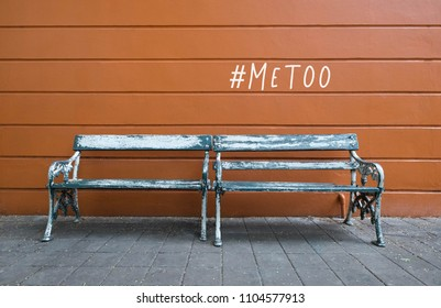 Two old wooden chairs and #metoo words on the walls of the brown walls. As part of anti sexual harassment and assault social media internet campaign protests