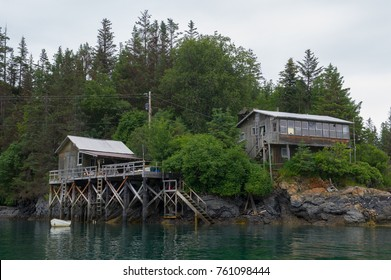 two old wooden houses on the shore of Halibut Cove, Kenai Peninsula, Alaska
