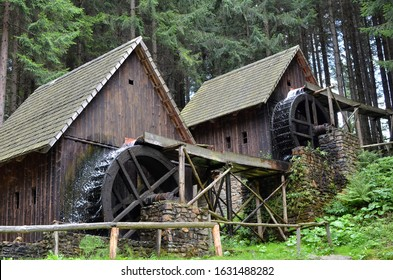two old wooden water mill with mill-wheel detail photo