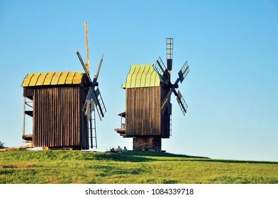 Two old wooden windmill on the field. Pirogovo Village, Kiev, Ukraine