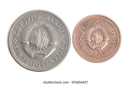 Two old and worn coins from 1980's Yugoslavia - 1 dinar and 25 para, with yugoslavian coat of arms. High resolution macro photograph.