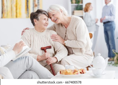Two older best friends spending time together in nursing home