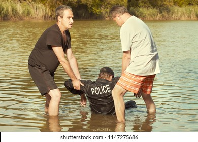 Two older men attacking and lynching police man by summer lake