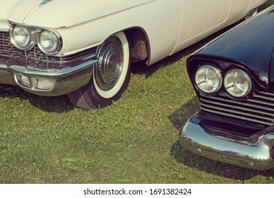 two old-fashioned classic american cars