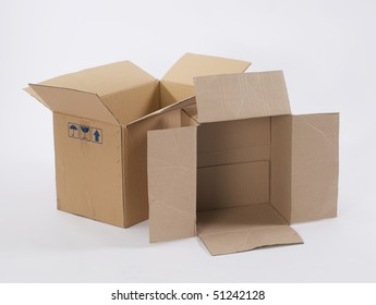 two opened cardboard boxes on plain background