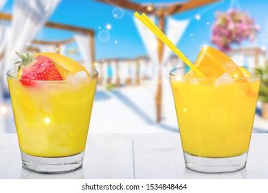 Two Orange Cocktails on summer background