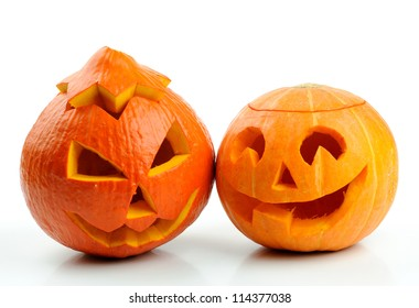 Two orange halloween pumpkins Jack O Lanterns isolated on white background