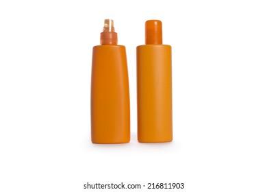 Two orange plastic bottles  isolated on white